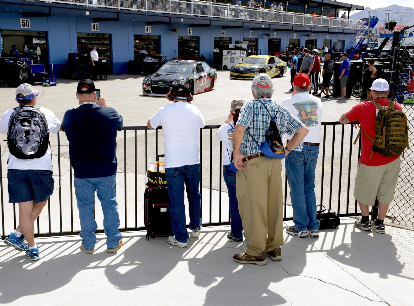 Fans watch as #33 Jeffrey Earnhardt and #6 TArevor Bayne leave the pit area for the track during NASCAR Stratosphere Pole Day at Las Vegas Motor Speedway. Friday, March 10, 2017. (Glenn Pinkerton/Las Vegas News Bureau)